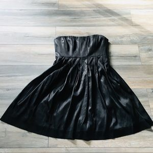 Black Calvin Klein cocktail dress with pintucks
